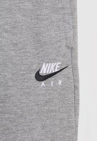 Nike Sportswear - AIR UNISEX - Tracksuit bottoms - dark grey heather - 2