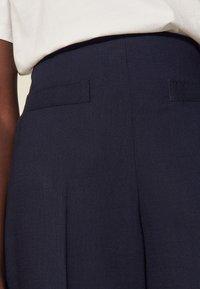 sandro - ENRIQUE - Trousers - marine - 4