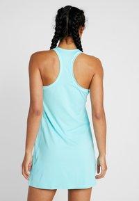 Nike Performance - DRY DRESS - Sportovní šaty - light aqua/white - 2