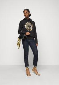 Versace Jeans Couture - Sweatshirt - black-gold - 1