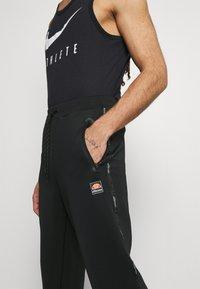 Ellesse - ROMFORD - Pantalones deportivos - black - 3