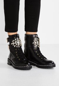 Kurt Geiger London - STOOP - Lace-up ankle boots - black - 0