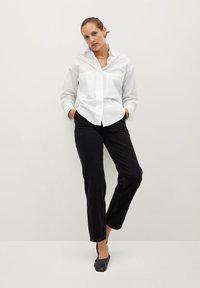 Mango - PROMISE - Button-down blouse - blanc cassé - 1