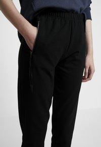 Masai - PERRY LEGGINGS - Spodnie treningowe - black - 5