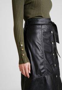 Ibana - FLO - A-line skirt - black - 3