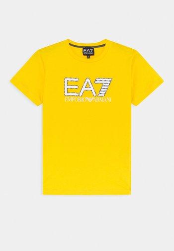 EA7 - Triko spotiskem - yellow