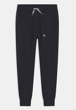 LIGHTWEIGHT - Tracksuit bottoms - black