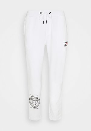 ONE PLANET UNISEX - Tracksuit bottoms - white