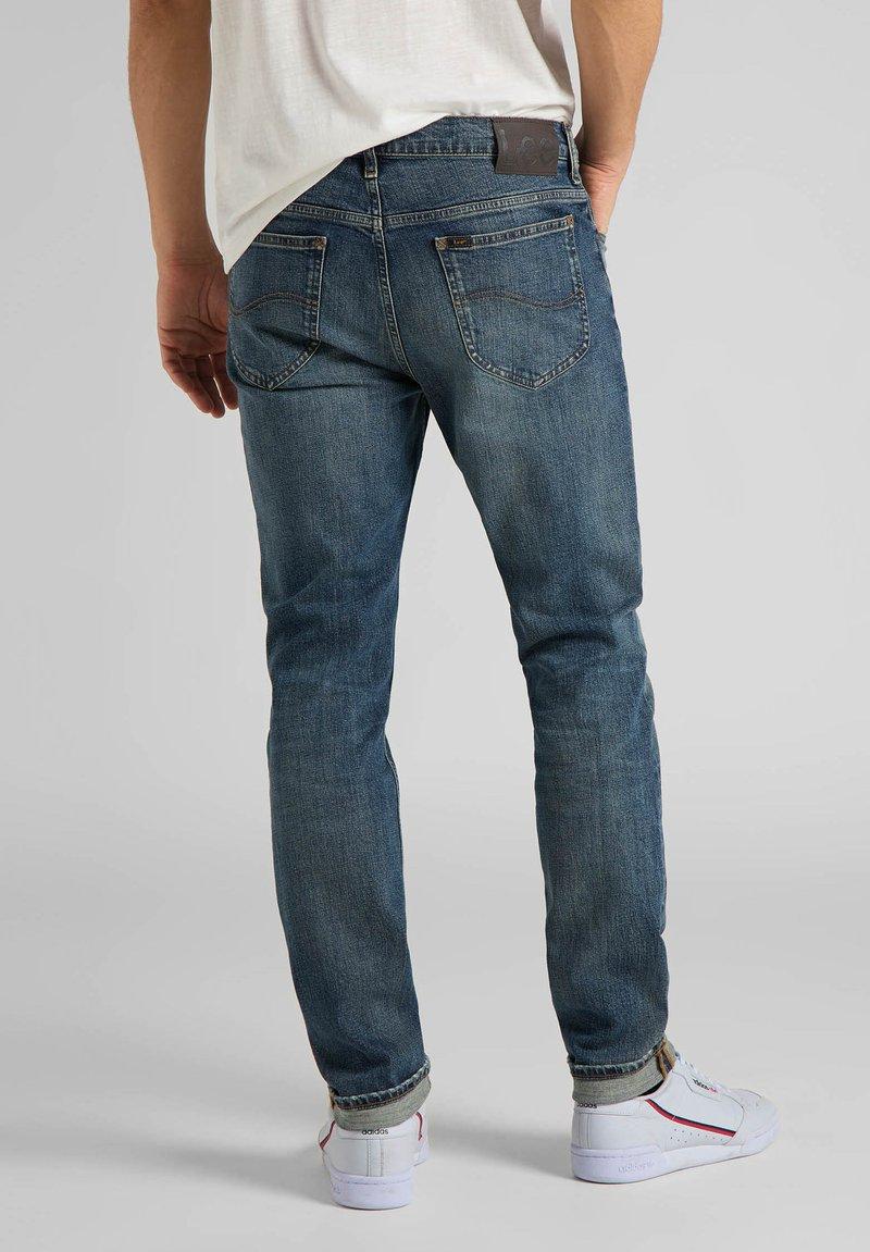 Lee RIDER - Jeans Slim Fit - mottled light blue/hellblau-meliert c1Ignl