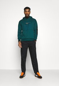 Nike Performance - DRY PANT TEAM  - Tracksuit bottoms - black - 1