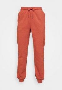 KARDI PANTS - Tracksuit bottoms - orange