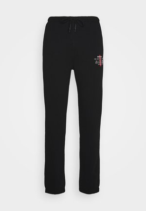 PETER - Tracksuit bottoms - black