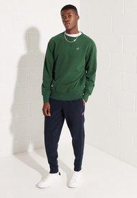 Superdry - Sweatshirt - dark green - 0