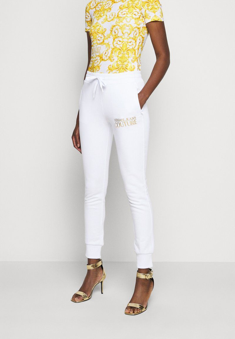 Versace Jeans Couture - Tracksuit bottoms - optical white/gold