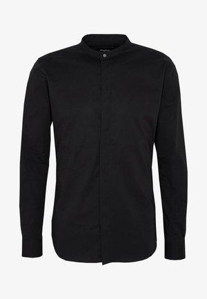 OLE STRETCH - Shirt - black