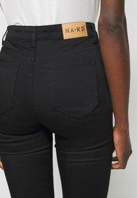 NA-KD Tall - HIGH WAIST RAW  - Jeans Skinny Fit - black - 4