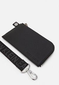 Calvin Klein Jeans - ZIP AROUND WRISTLET - Wallet - black - 4