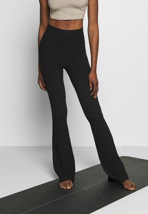 FLARED PANTS - Verryttelyhousut - black