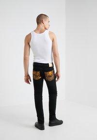 Versace Jeans Couture - PANTALONI UOMO - Slim fit jeans - nero - 2