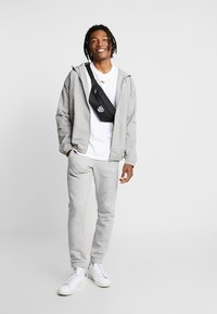 adidas Originals - OUTLINE WINDBREAKER JACKET - Summer jacket - solid grey - 1