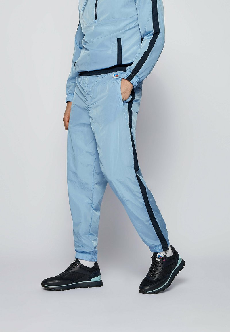 BOSS - JANYL_RA - Tracksuit bottoms - open blue