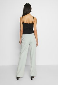 Missguided - BELT DETAIL STRAIGHT LEG TROUSERS - Pantalon classique - mint