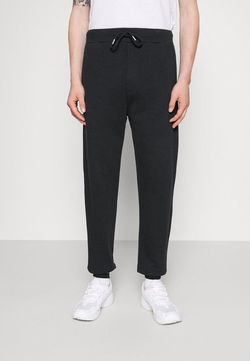 Diesel - UMLB-PETER-BG TROUSERS - Pantaloni sportivi - black