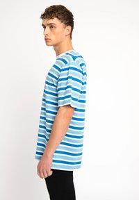 Urban Threads - T-shirts print - blue - 2