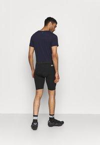Rukka - RUOVE - Sports shorts - black - 2