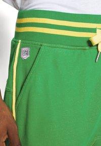 Schott - PAUL MODE - Tracksuit bottoms - bresil green/yellow - 3