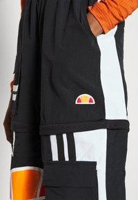 Ellesse - OLTUS TRACK PANT - Pantalones deportivos - black - 6