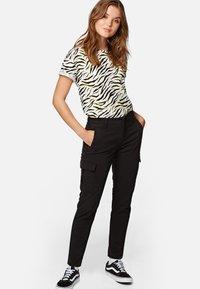 Mavi - JULIA - Trousers - black - 1