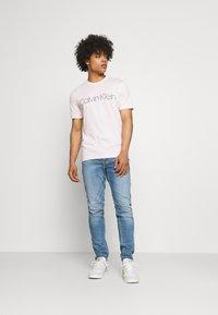 Levi's® - TAPER LO BALL - Jeans slim fit - dolf bombay - 1