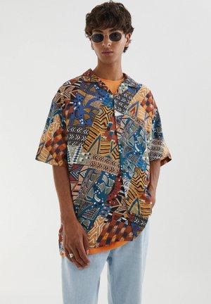 Shirt - mottled light brown