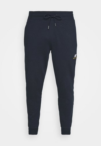 ESSENTIALS EMBRIODERED PANT - Tracksuit bottoms - dark blue
