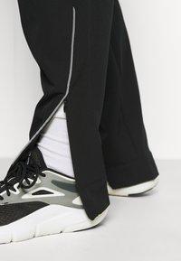 Kari Traa - TIRILL PANT - Tracksuit bottoms - black - 3