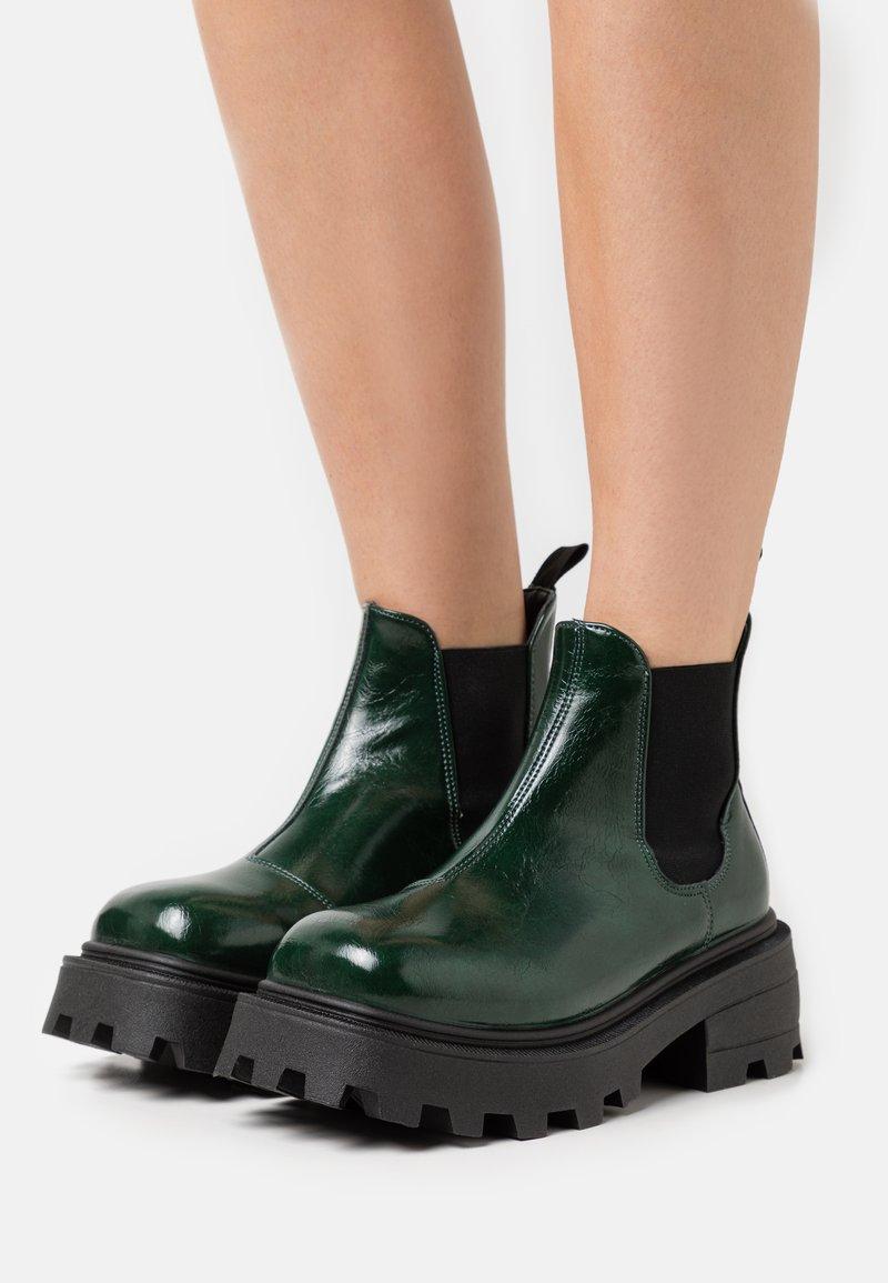 Topshop - KYLIE CHELSEA SQUARE TOE BOOT - Platform ankle boots - bottle green