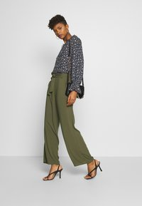 ONLY - ONLNOVA LIFE PALAZZO PANT SOLID - Trousers - grape leaf - 1