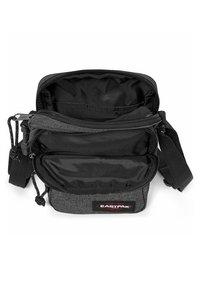 Eastpak - DOUBLE ONE CORE COLORS - Across body bag - black denim - 3