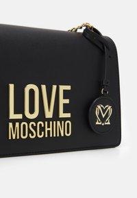 Love Moschino - Across body bag - black - 4