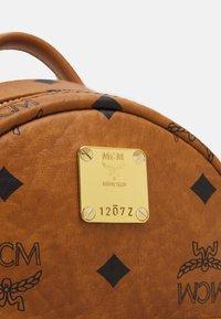 MCM - STARK BACKPACK MINI - Sports bag - cognac - 4
