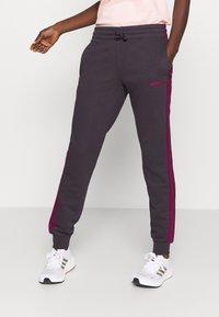 adidas Performance - PANT - Tracksuit bottoms - purple - 0
