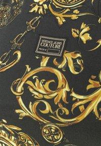 Versace Jeans Couture - Print T-shirt - black/gold - 5
