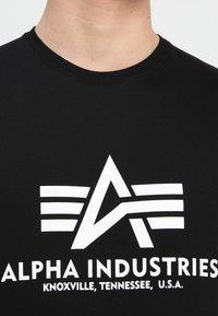 Alpha Industries - BASIC - Camiseta estampada - schwarz - 4