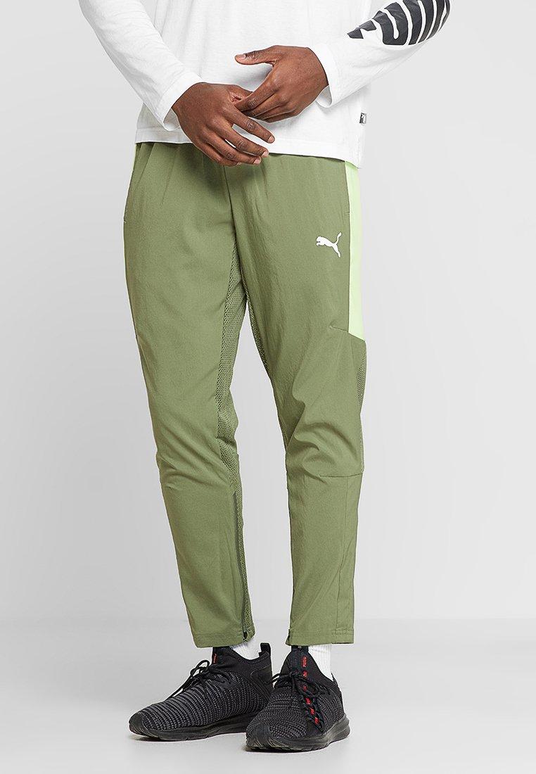 Puma - ENERGY PANT - Pantalon de survêtement - olivine/yellow