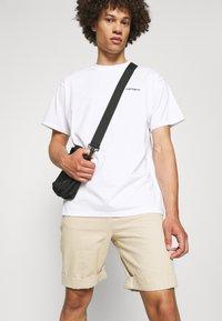 Carhartt WIP - SCRIPT EMBROIDERY - Basic T-shirt - white/black - 3