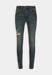 STOCKHOLM DESTROY - Slim fit jeans - egyptian blue