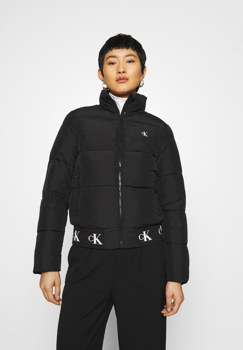 Calvin Klein Jeans - REPEATED LOGO PUFFER - Kurtka zimowa - black