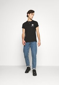 Jack & Jones - JJICHRIS JJORIGINAL - Straight leg jeans - blue denim - 1