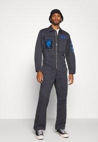 Diesel - P-LARRY TROUSERS UNISEX - Jumpsuit - grey blue - 1